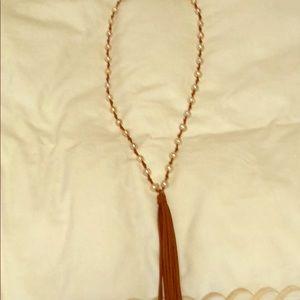 Long tassel necklace.